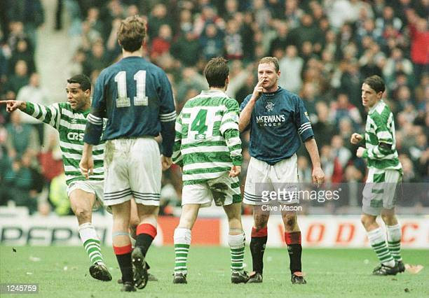 Paul Gascoigne of Rangers blows a kiss to Jackie Mcnamara of Celtic after a foul during the Rangers v Celtic Scottish Premiership match at Ibrox Park...