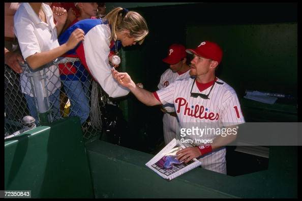 Shortstop Kevin Stocker of the Philadelphia Phillies signs autographs during a game against the St Louis Cardinals at Jack Russell Stadium in Florida