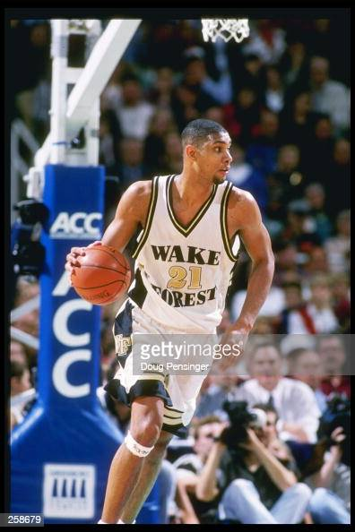 Center Tim Duncan of the Wake Forest Demon Deacons dribbles the court during a playoff game against the Florida State Seminoles at the Greensboro...