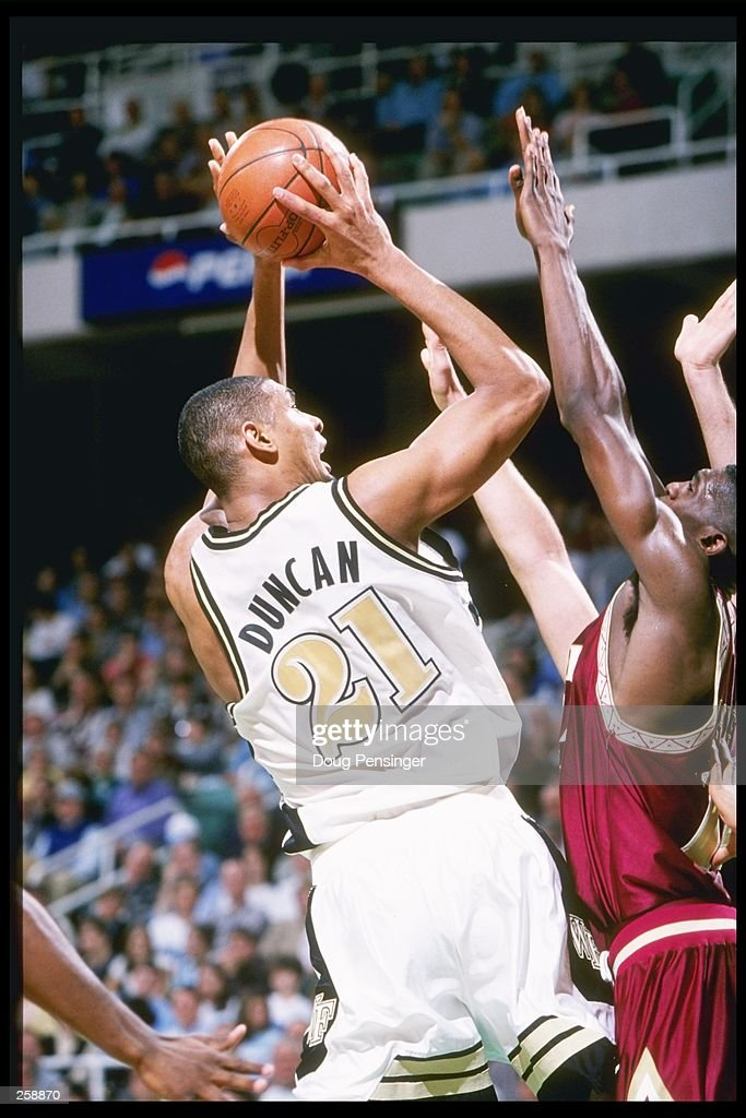 Center Tim Duncan of the Wake Forest Demon Deacons shoots the ball during a playoff game against the Florida State Seminoles at the Greensboro...