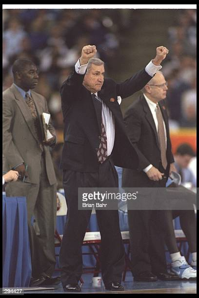 Coach Dean Smith of the North Carolina Tarheels holds up his hands during an NCAA Final Four game against the Arizona Wildcats at the RCA Dome in...