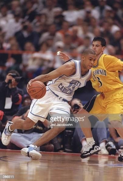 Forward Antawn Jamison of the University of North Carolina Tarheels drives towards the basket as guard Randy Duck of the California Bears defends him...