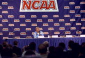 Head coach Dean Smith of the North Carolina Tar Heels speaks to the press during a practice session for the NCAA East Regionals playoffs at the...