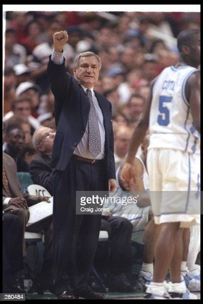 Head Coach Dean Smith of the University of North Carolina calls a play from the sideline during the Tarheels 6454 win over North Carolina State to...