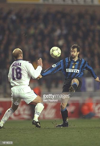 Maurizio Ganz of Inter Milan competes with Suvad Katana of RSC Anderlecht during the UEFA Cup Quarter Final at the Constant Van Den Stock Stadium...