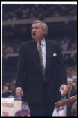 North Carolina Tar Heels head coach Dean Smith looks on during a playoff game against the California Golden Bears at the Carrier Dome in Syracuse New...
