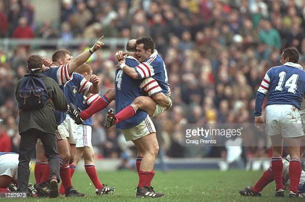 Olivier Merle and Alain Penaud celebrate victory over England in the Five Nations Championship game at Twickenham France won 23 20 Mandatory Credit...