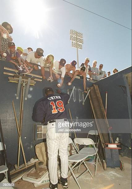 Right fielder Tony Gwynn of the San Diego Padres signs autographs during spring training game against the Oakland Athletics in Peoria Arizona...