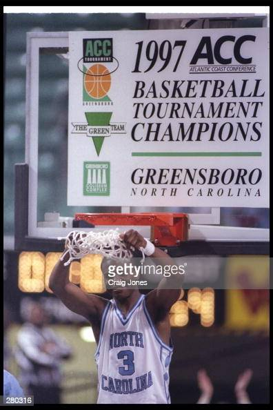 Shammond Williams of the University of North Carolina raises up the game net during the Tarheels 6454 win over North Carolina State to become the ACC...