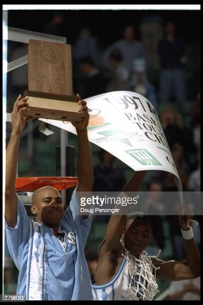 Vince Carter of the University of North Carolina celebrates with teammate Shammond Williams after Tarheels 6454 win over North Carolina State to...