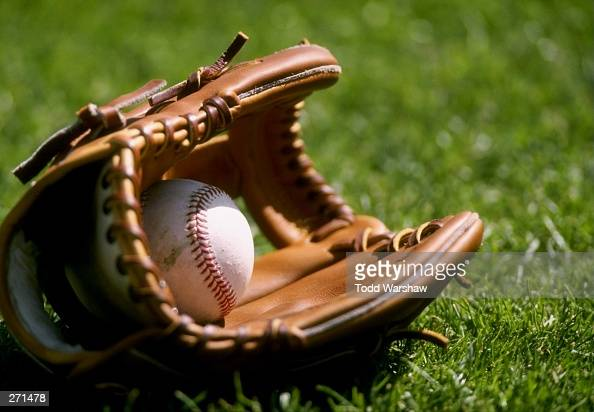 A general view of a baseball laying in a glove on the grass during an Arizona Diamondbacks spring training game against the Chicago Cubs at Hohkam...
