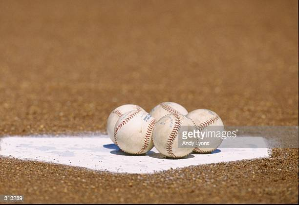 A general view of a group of baseballs on home plate during a spring training game against the Kansas City Royals and the New York Yankees at...