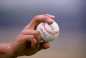A general view of a pitcher gripping a baseball during the Colorado Rockies v San Diego Padres spring training game at the Peoria Sports Complex in...