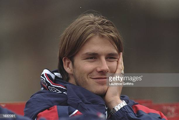 David Beckham of England and Manchester United gives a cheeky smile during an England training session before the friendly against Switzerland...