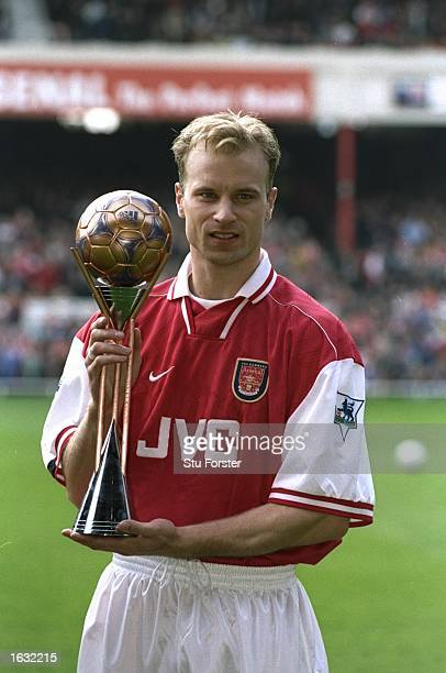 Dennis Bergkamp of Arsenal with the FIFA Player of the Year Bronze award before the FA Carling Premiership match against Sheffield Wednesday at...