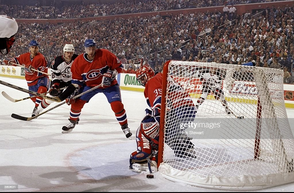 Goaltender Andy Moog and defenseman Patrice Brisebois of the Montreal Canadiens in action during an NHL playoff game against the Buffalo Sabres at...