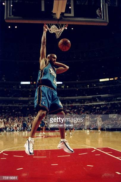 Grant Hill of the Detroit Pistons slam dunks the ball during a game against the Chicago Bulls at the United Center in Chicago Illinois The Bulls...