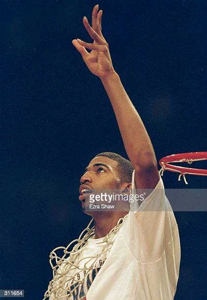 Guard Richard Hamilton of the Connecticut Huskies celebrates with a net around his neck after the Big East Tournament Final against the Syracuse...