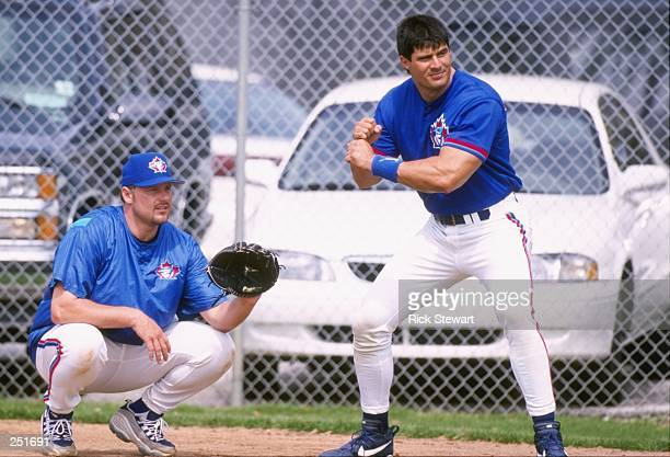 Jose Canseco and Roger Clemens of the Toronto Blue Jays play around after a spring training game against the Pittsburgh Pirates at the Dunedin...