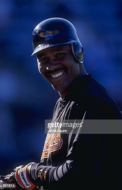 Outfielder Joe Carter of the Baltimore Orioles in action during a spring training game against the Montreal Expos at the Fort Lauderdale Stadium in...