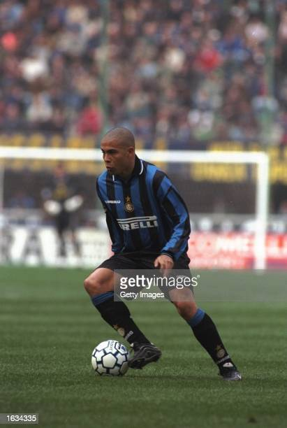 Ronaldo of Inter dribbles with the ball during the match between Inter Milan and Vicenza in the Italian Serie A played at the San Siro Stadium Milan...