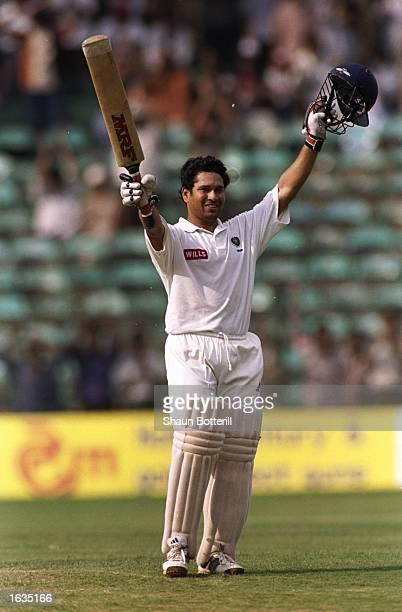 Sachin Tendulkar of India celebrates reaching the century mark during the third test between India and Australia played in Bangalore India Australia...