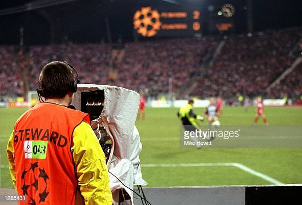 A cameraman catches the action in the UEFA Champions League quarterfinal first leg match between Bayern Munich and Kaiserslautern at the...