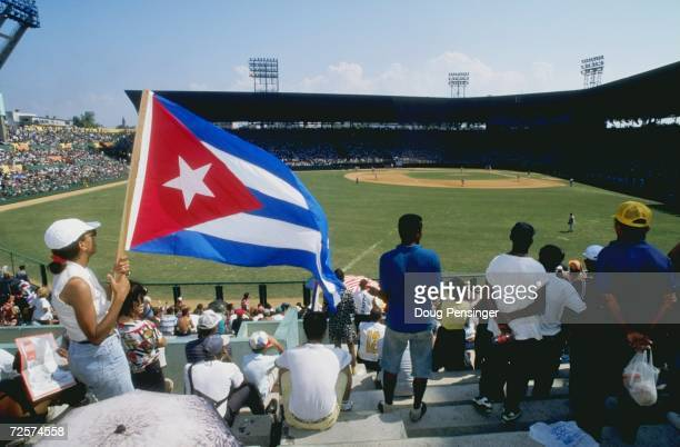 A general view of the Cuban Fans sitting in the outfield blechers watching the game between the Baltimore Orioles and the Cuban National Team at the...