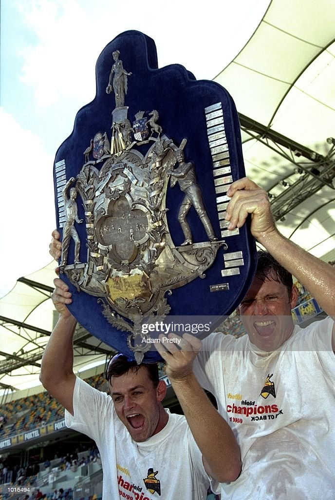 Adam Gilchrist and Tom Moody of WA celebrate with the Sheffield Shield after the Sheffield Shield Final between Western Australia and Queensland at the ''Gabba'', Brisbane Cricket Ground, Woolloongabba, Brisbane, Australia. \ Mandatory Credit: Adam Pretty /Allsport