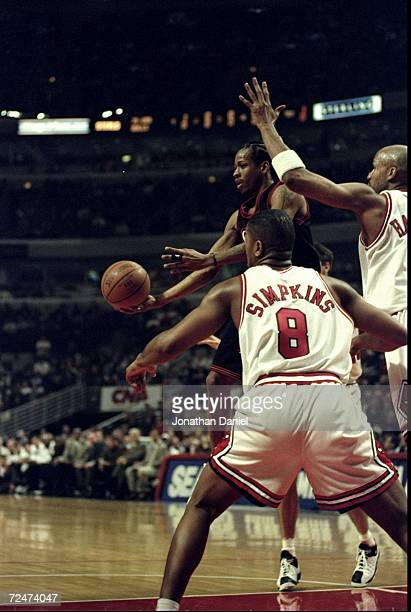 Allen Iverson of the Philadelphia 76ers passing the ball off during the game against the Chicago Bulls at the United Center in Chicago Illinois The...