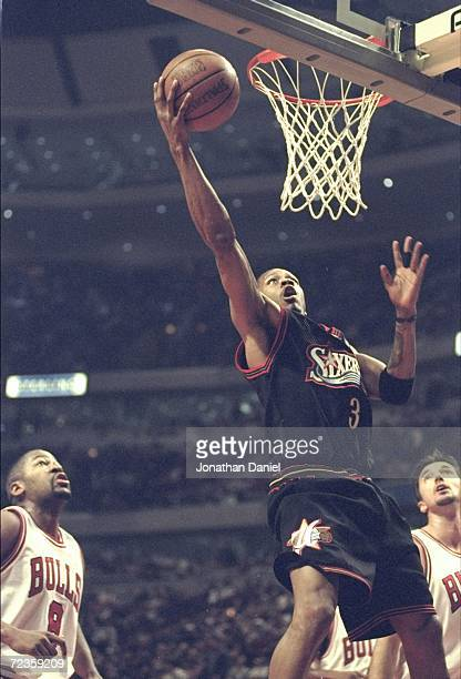 Allen Iverson of the Philadelphia 76ers putting the ball in the basket during the game against the Chicago Bulls at the United Center in Chicago...