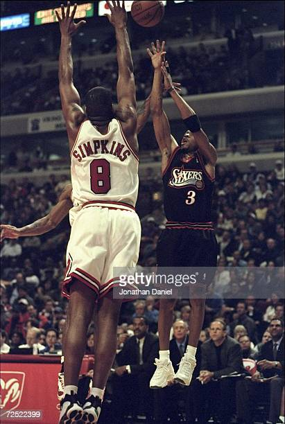 Allen Iverson of the Philadelphia 76ers taking a jump shot during the game against the Chicago Bulls at the United Center in Chicago Illinois The...