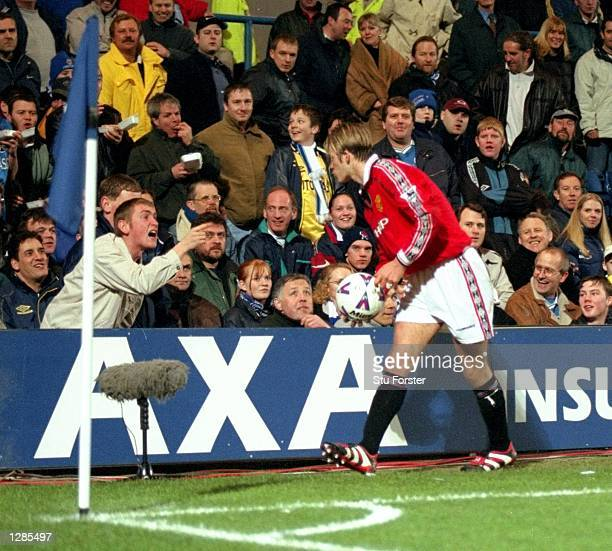 David Beckham of Manchester United blows a kiss to Chelsea supporter during the FA Cup quarterfinal replay at Stamford Bridge in London United won 20...