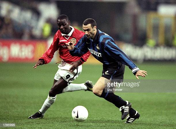 Giuseppe Bergomi of Inter Milan is chased by Andy Cole of Manchester United in the UEFA Champions League quarterfinal second leg match at the San...