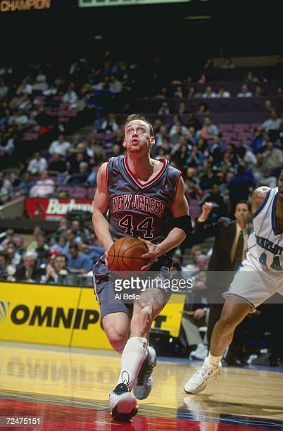 Keith Van Horn of the New Jersey Nets taking the ball to the basket during the game against the Charlotte Hornets at the Continental Airlines Arena...