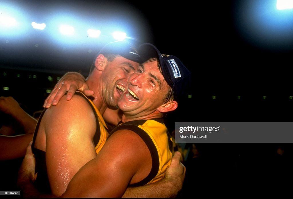 The Hawthorn players celebrate victory after winning the 1999 Ansett Cup Grand Final match against Port Adelaide played \ Mandatory Credit: Mark Dadswell /Allsport