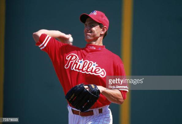 Andy Ashby of the Philadelphia Phillies pitches the ball during the Spring Training Game against the Cleveland Indians at the Jack Russell Stadium in...