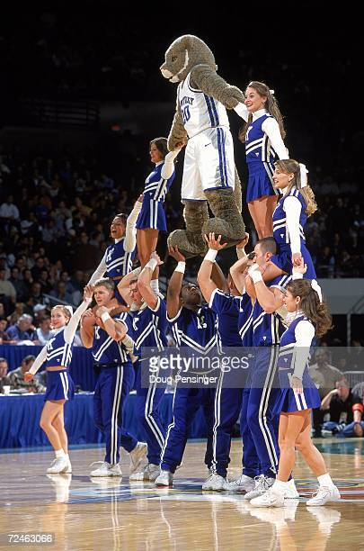 Cheerleader of the Kentucky Wildcats make a pyramid on center court during round one of the NCAA Mid West Regoinal Game against the St Bonaventure...