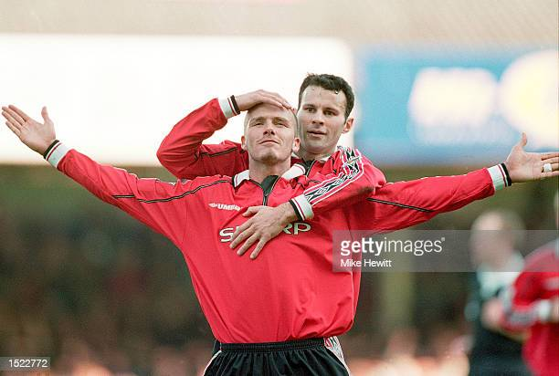 David Beckham of Manchester United is congratulated by teammate Ryan Giggs after scoring during the FA Carling Premiership match against Leicester...