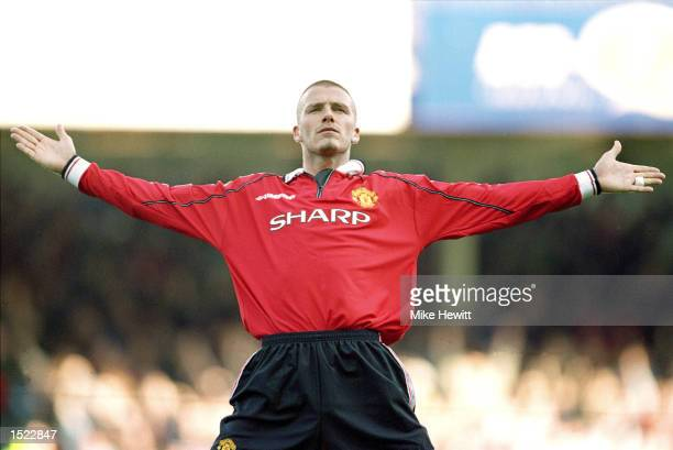 David Beckham of Manchester United milks the applause after scoring in the FA Carling Premiership match against Leicester City at Filbert Street in...