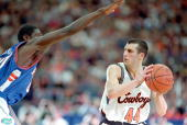 Doug Gottlieb of the Oklahoma Sooners with the ball as Brent Wright of the Florida Gators gaurds him during the NCAA East East Regional Game at the...