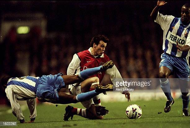 Fredrik Ljungberg of Arsenal and Djalminha of Deportivo La Coruna battle for control during the UEFA Cup fourth round first leg game played at...