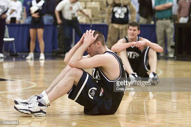 Guard Andrew Graves and center Scott Robisch of the Butler Bulldogs sit in dejection after their 6968 overtime loss to the Florida Gators during...