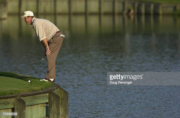 Hal Sutton lines up his putt on the par three 17th hole after his tee shot went in the water during the third round of the Tournament Players...