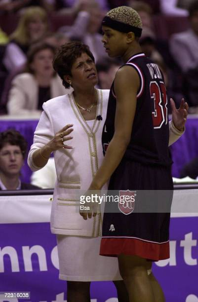Head coach Vivian Stringer talks with Kourtney Walton of Rutgers during a timeout against Tennessee during the NCAA Women''s Final Four at the First...