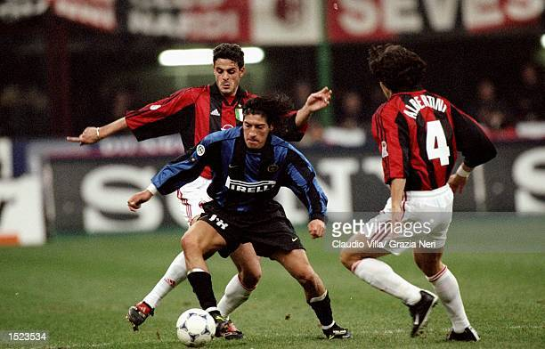 Ivan Zamorano of Inter Milan skips past Luigi Sala and Demetrio Albertini of Milan during the Italian Serie A game between Milan and Inter Milan at...