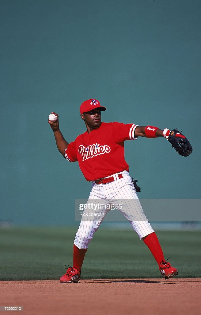 Jimmy Rollins of the Philadelphia Phillies throws the ball during the Spring Training Game against the Cleveland Indians at the Jack Russell Stadium...