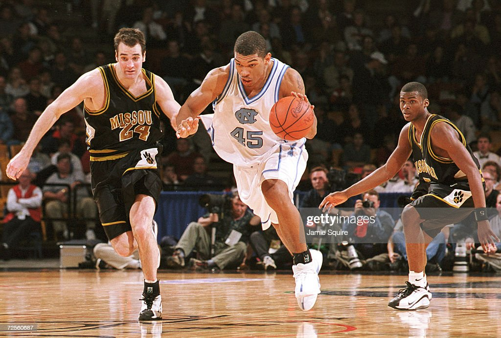 Julius Peppers of UNC drives down the court on Jeff Hafer of Missouri during the second half of North Carolina''s 8470 victory at the NCAA tournament...