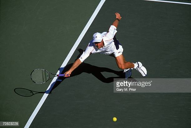 Magnus Norman of Sweden reaches for the ball during the Indian Wells Masters Series at Indian Wells Tennis Gardens in Indian Wells California...