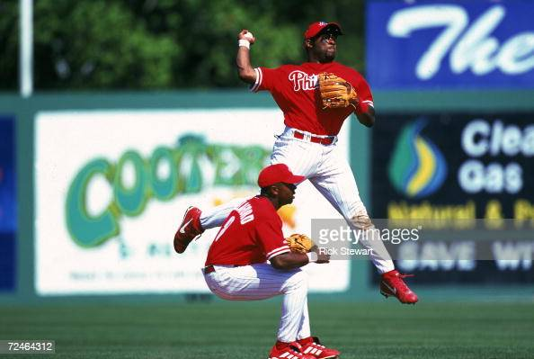 Marlon Anderson of the Philadelphia Phillies throws the ball during the Spring Training Game against the Cleveland Indians at the Jack Russell...